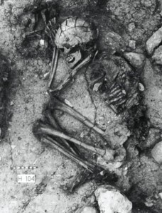 A human cradles a puppy in this 10,000 BC find in northern Israel. (Credit: Davis et al., Nature, 276, 608-610)
